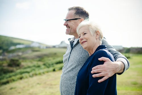 A mature couple admiring the view and feeling great after attending a marriage healing retreat.