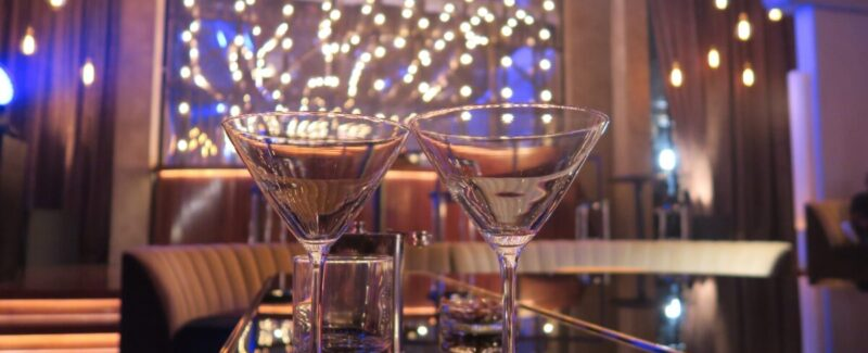 Martini glasses placed on a luxurious bar.