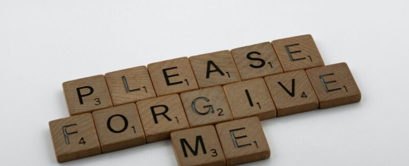 "Scrabble tiles that read ""Please forgive me."""