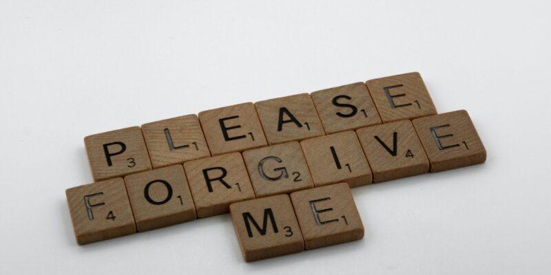 """Scrabble tiles that read """"Please forgive me."""""""
