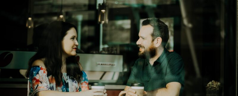 Couple having coffee while respectfully talking