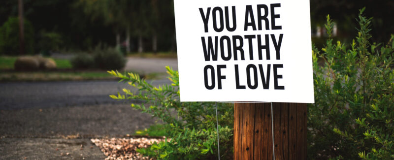 """Sign stating """"You are worthy of love."""""""